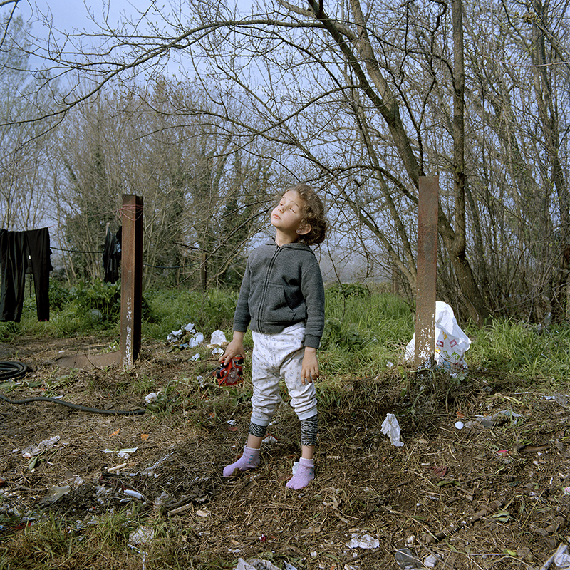 Between Heaven and Hell; blind girl playing in a dumpsite near an impromptu refugee campsite in Eidomeni- Greece; 2016