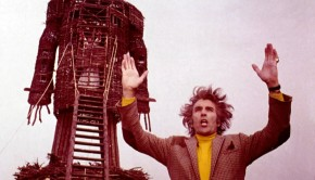 wicker-man-the-1973-013-christopher-lee-hands-aloft-before-wicker-man