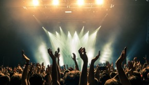 Concert-crowd-with-silhouettes-of-people-hold-their-hands-up